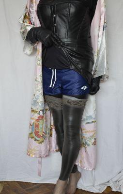Bondage girls wearing a pair of Umbro navy blue nylon shorts